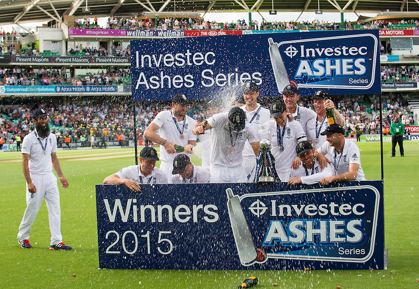 England's Alastair Cook gets champagne by Jimmy Anderson as they win back the Ashes 3-2<br /> <br /> Photographer Ashley Western/CameraSport<br /> <br /> International Cricket - Investec Ashes Test Series 2015 - Fifth Test - England v Australia - Day 4 - Sunday 23rd August 2015 - Kennington Oval - London<br /> <br /> &copy; CameraSport - 43 Linden Ave. Countesthorpe. Leicester. England. LE8 5PG - Tel: +44 (0) 116 277 4147 - admin@camerasport.com - www.camerasport.com