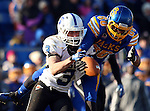 BROOKINGS, SD - NOVEMBER 9:  Trevor Wesley #80 from South Dakota State University has the ball knocked from his hands by Donovan Layne #3 from Indiana State University Saturday at Coughlin Alumni Stadium. (Photo by Dave Eggen/Inertia)