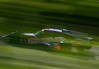 #0 DeltaWing racer of Katherine Legge and Andy Meyrick, through the trees, IMSA Tudor Series Race, Road America, Elkhart Lake, WI, August 2014.  (Photo by Brian Cleary/ www.bcpix.com )