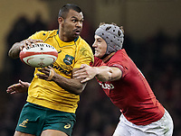 Australia's Kurtley Beale is tackled by  Wales' Jonathan Davies<br /> <br /> Photographer Simon King/CameraSport<br /> <br /> International Rugby Union - 2017 Under Armour Series Autumn Internationals - Wales v Australia - Saturday 11th November 2017 - Principality Stadium - Cardiff<br /> <br /> World Copyright &copy; 2017 CameraSport. All rights reserved. 43 Linden Ave. Countesthorpe. Leicester. England. LE8 5PG - Tel: +44 (0) 116 277 4147 - admin@camerasport.com - www.camerasport.com