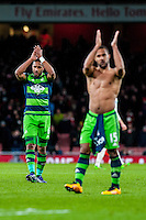 Ashley Williams of Swansea City  ( left )  applauds fans after the final of the the Barclays Premier League match between Arsenal and Swansea City at the Emirates Stadium, London, UK, Wednesday 02 March 2016