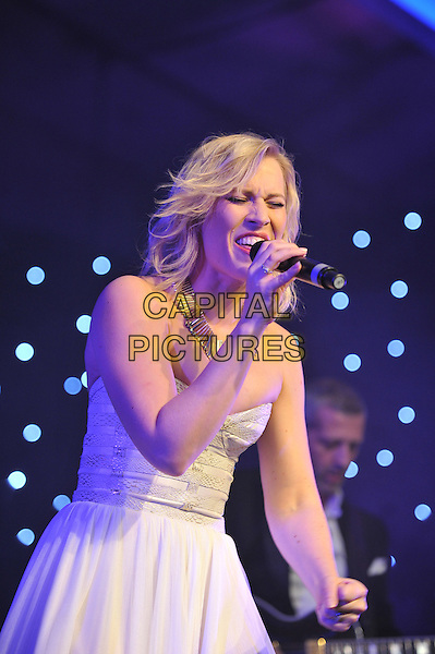 Natasha Bedingfield .'Global Angels Awards', The Park Plaza Hotel, Westminster, London, England. 2nd December 2011..music on stage live concert gig performing half length microphone singing  white strapless dress .CAP/MAR.© Martin Harris/Capital Pictures.