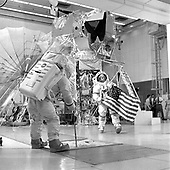 Apollo 14 flight crew during lunar EVA training at the John F. Kennedy space Center at Cape Canaveral, Florida on December 8, 1970.  Mission Commander Alan B. Shepard is walking with the American flag in his hands.<br /> Credit: NASA via CNP