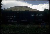 Box car #3661 with barren hill in background. Scene is at Colorado Rail Road Museum.<br /> D&amp;RGW  Golden, CO