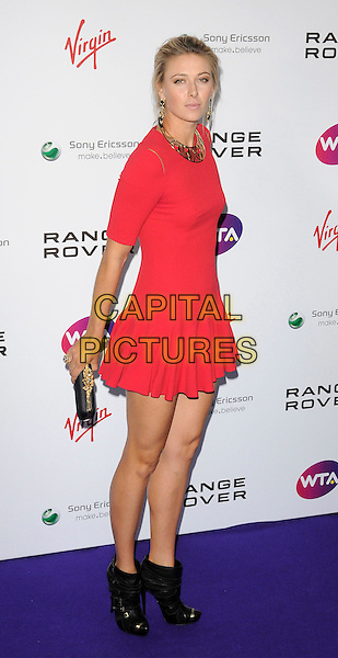 Maria Sharapova .attending the WTA Tour Pre-Wimbledon Party at The Roof Gardens, Kensington, London, England, UK, .16th June 2011.full length red dress  skater skirt black ankle boots clutch bag gold .CAP/CAN.©Can Nguyen/Capital Pictures.
