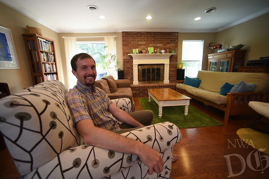 Northwest Arkansas Democrat Gazette/SPENCER TIREY<br /> Clint Shnekloth in the living room of his home in Fayetteville Arkansas Friday Sept. 18, 2105.
