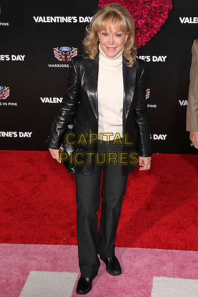 """BARBARA EDEN.Arrivals to the world premiere of """"Valentine's Day"""" at Grauman's Chinese Theater in Hollywood, California, USA. .February 8th, 2010. .full length cream beige polo neck sweater jumper jacket black leather clutch bag trousers .CAP/CEL.©CelPh/Capital Pictures"""