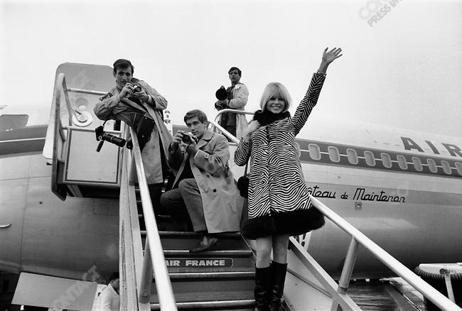 Brigitte Bardot leaving for the USA from Le Bourget Airport; photographer Douglas Kirkland (kneeling), France, December 1965