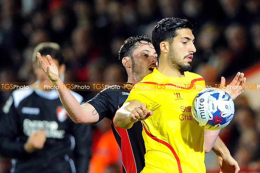 Adam Smith of AFC Bournemouth and Emre Can of Liverpool contest for the ball - AFC Bournemouth vs Liverpool - Capital One Cup Quarter-Final Football at the Goldsands Stadium, Bournemouth, Dorset - 17/12/14 - MANDATORY CREDIT: Denis Murphy/TGSPHOTO - Self billing applies where appropriate - contact@tgsphoto.co.uk - NO UNPAID USE