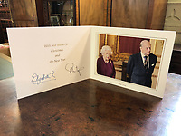BNPS.co.uk (01202 558833)<br /> Pic: Charterhouse/BNPS<br /> <br /> The 2019 Christmas card, which would have been sent just two months ago, features a photo of the Queen and Prince Philip taken last May.<br /> <br /> The fascinating archive of a longstanding member of staff to the Royal family has emerged for sale.<br /> <br /> It features a selection of Royal Christmas cards, including one from 2019, as well as a slice of wedding cake and an order of service from Charles and Diana's wedding in 1981.<br /> <br /> The vendor, who wishes to remain anonymous, is also selling their Royal 'personal service' medal and the menu and seat plan for a state banquet in 1980.<br /> <br /> They worked at Buckingham Palace from the late 70s to the beginning of the 21st century, receiving Christmas cards every year since as a token of their service.<br /> <br /> The collection is being sold with Charterhouse Auctioneers, of Sherborne, Dorset. It is expected to fetch £1,500.