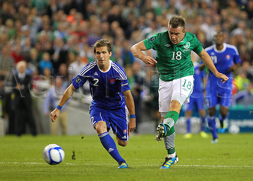 02.09.2011 Euro 2012 International Group B Qualifier from the Aviva stadium in Dublin. Rep of Ireland v Slovakia. Simon Cox (Rep. of Ireland) gets by Peter Pekarik (Slovakia) and has a shot on goal which goes just wide.