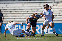Sanford, FL - Saturday Oct. 14, 2017:  A Courage player tries to dribble through a sliding challenge during a US Soccer Girls' Development Academy match between Orlando Pride and NC Courage at Seminole Soccer Complex. The Courage defeated the Pride 3-1.
