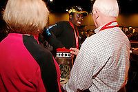 Thursday March 4, 2010      .Jamaican musher Newton Marshall draws his starting number from a mukluk at the musher's drawing banquet in Anchorage ...