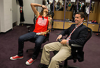 Jun. 10, 2013; Phoenix, AZ, USA: Phoenix Mercury center Brittney Griner (left) reacts as she scores a three pointer while playing NBA 2K13 with  writer Scott Gleeson on an Xbox in the teams locker room at the US Airways Center. Mandatory Credit: Mark J. Rebilas-