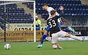 Queen of the South's Mark Durnan pulls down Falkirk's Rory Loy for Falkirk's first half penalty.