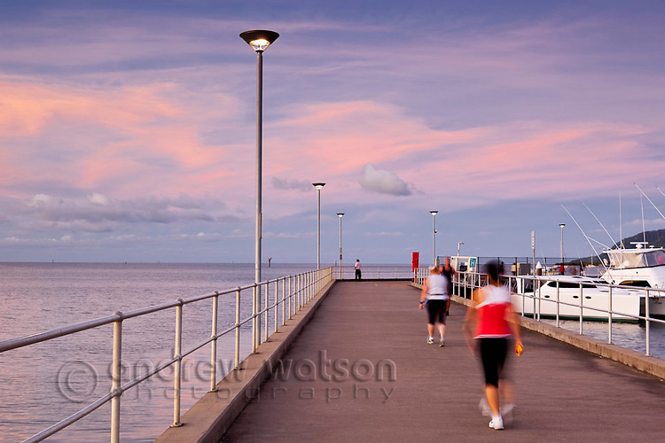View along the Marlin Marina jetty at dusk.  Cairns, Queensland, Australia