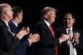 United States President Donald Trump (C) applauds at the National Prayer Breakfast February 2, 2017 in Washington, DC. Every U.S. president since Dwight Eisenhower has addressed the annual event. Also pictured (L-R) are Rep. Robert Aderholt (R-AL), television producer Mark Burnett, and Sen. John Boozman (R-AR).  <br /> Credit: Win McNamee / Pool via CNP