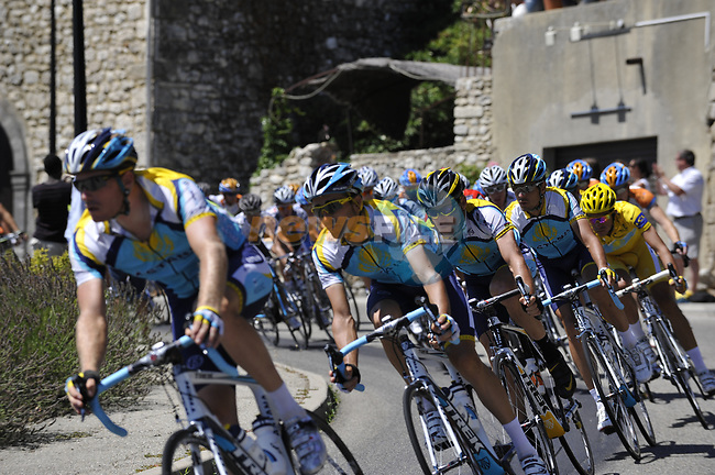 The peleton led by Astana team including Lance Armstrong (USA) pass through the medieval village of Salles Sous Bois during the penultimate Stage 19 to Mont Ventoux during the Tour de France 2009 running 167km from Montelimar to Mont Ventoux, France. 25th July 2009 (Photo by Eoin Clarke/NEWSFILE)
