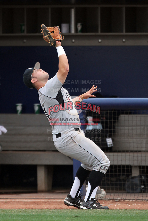 Ino Patron #4 of the Long Beach St. 49'ers catches a pop foul ball against the Cal. St. Fullerton Titans at Goodwin Field in Fullerton,California on May 14, 2011. Photo by Larry Goren/Four Seam Images