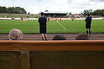 Berwick Rangers 5 East Stirlingshire 0, 23/08/2014. Shielfield Park, Scottish League Two. The respective benches watching the action at Shielfield Park, during the Scottish League Two fixture between Berwick Rangers and East Stirlingshire, in a stadium which also doubles as a professional speedway track. The home club occupied a unique position in Scottish football as they are based in Berwick-upon-Tweed, which lies a few miles inside England. Berwick won the match by 5-0, watched by a crowd of 509. Photo by Colin McPherson.