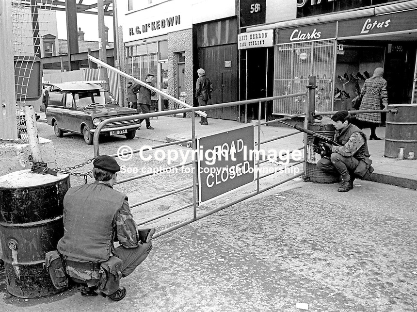 Security checkpoint in Lurgan, Craigavon, Co Armagh, N Ireland, where RUC Police Inspector James Harold Cobb was shot dead by Provisional IRA gunmen, 24th February 1977. Two reserve policemen were also injured in the incident. Two men were later jailed for life in connection with the killing.  197702240036a<br /> <br /> Copyright Image from Victor Patterson, 54 Dorchester Park, Belfast, UK, BT9 6RJ<br /> <br /> Tel: +44 28 9066 1296<br /> Mob: +44 7802 353836<br /> Voicemail +44 20 8816 7153<br /> Email: victorpatterson@me.com<br /> Email: victorpatterson@gmail.com<br /> <br /> IMPORTANT: My Terms and Conditions of Business are at www.victorpatterson.com