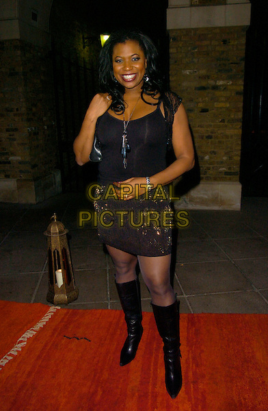 BRENDA EDWARDS.at Alesha Dixon's End of Year Party at Kenza restaurant..29th December 2007 London, England.full length black top skirt knee high boots .CAP/CAN.©Can Nguyen/Capital Pictures.