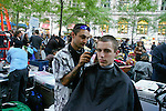 Man gets hair cut at the Occupy Wall Street Protest in New York City October 6, 2011.