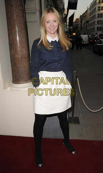 Kate Reardon.Alexandra Shulman's 'Can We Still Be Friends?' debut novel launch party, Sotheby's, New Bond St., London, England..March 28th, 2012.full length blue top white skirt black tights hands in pockets .CAP/CAN.©Can Nguyen/Capital Pictures.