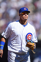 Chicago Cubs second baseman Javier Baez (9) jogs to the dugout during a game against the Milwaukee Brewers on August 14, 2014 at Wrigley Field in Chicago, Illinois.  Milwaukee defeated Chicago 6-2.  (Mike Janes/Four Seam Images)