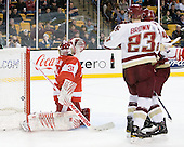 Kieran Millan (BU - 31), Patrick Brown (BC - 23), Bill Arnold (BC - 24) - The Boston College Eagles defeated the Boston University Terriers 3-2 (OT) in their Beanpot opener on Monday, February 7, 2011, at TD Garden in Boston, Massachusetts.