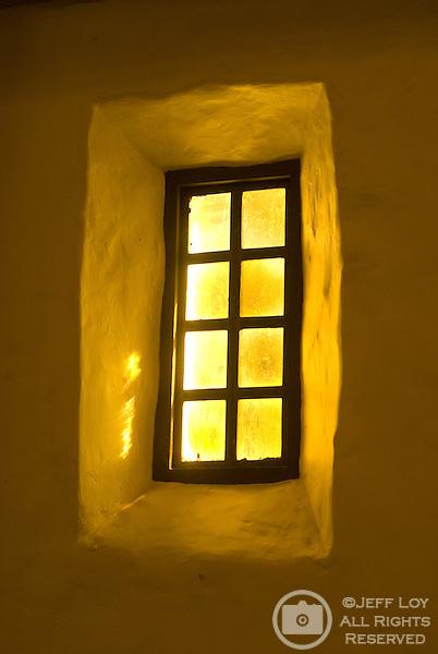 Sunlight shines through a window of Mission San Francisco de Asis in San Francisco, California.