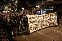 "Pictured: Protesters in helmets and armed with wooden bats holding a slogan reading ""Deep breath until the death of  capitalism and state"" Tuesday 02 December 2014<br />