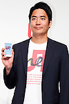 """Rei Matsunuma , Global Marketing Projector of UNIQLO Co., Ltd. shows from his smartphone the UTme! application during a special Uniqlo media event to promote the """"UTme!"""" smart phone application on April 28, 2015. The application allows customers to upload their own designs to sell through """"UTme! Market"""". Customers also can select new effects, characters and designs from Coca-Cola, Mottchy the Kakkoii-inu and fashion magazine Non-no. (Photo by Rodrigo Reyes Marin/AFLO)"""
