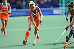 The Hague, Netherlands, June 14: Carlien Dirkse van den Heuvel #9 of The Netherlands dribbles the ball during the field hockey gold medal match (Women) between Australia and The Netherlands on June 14, 2014 during the World Cup 2014 at Kyocera Stadium in The Hague, Netherlands. Final score 2-0 (2-0)  (Photo by Dirk Markgraf / www.265-images.com) *** Local caption ***