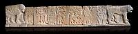 Pictures & images of the North Gate Hittite sculpture stele depicting Hittite Gods. 8th century BC. Karatepe Aslantas Open-Air Museum (Karatepe-Aslantaş Açık Hava Müzesi), Osmaniye Province, Turkey. Against black background