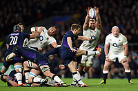 Greig Laidlaw of Scotland box-kicks the ball as George Kruis of England looks to charge him down. Guinness Six Nations match between England and Scotland on March 16, 2019 at Twickenham Stadium in London, England. Photo by: Patrick Khachfe / Onside Images