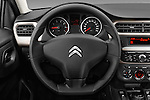 Car pictures of steering wheel view of a 2016 Citroen C-Elysee Confort 4 Door Sedan Steering Wheel