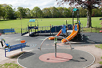 Newly refurbished by Rushmoor Borough Council, playground where some of the equipment is designed for disabled children.  The flooring is very soft rubber matting to minimise injuries from falls.  King George V Playing Fields, Farnborough, Hampshire.