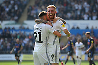 Oli McBurnie of Swansea City celebrates scoring his side's equalising goal to make the score 1-1 during the Sky Bet Championship match between Swansea City and Rotherham United at the Liberty Stadium in Swansea, Wales, UK.  Friday 19 April 2019