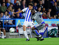 Lincoln City's John Akinde battles with Huddersfield Town's Rarmani Edmonds-Green<br /> <br /> Photographer Andrew Vaughan/CameraSport<br /> <br /> The Carabao Cup First Round - Huddersfield Town v Lincoln City - Tuesday 13th August 2019 - John Smith's Stadium - Huddersfield<br />  <br /> World Copyright © 2019 CameraSport. All rights reserved. 43 Linden Ave. Countesthorpe. Leicester. England. LE8 5PG - Tel: +44 (0) 116 277 4147 - admin@camerasport.com - www.camerasport.com