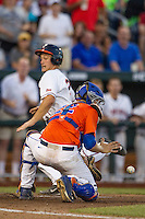 Florida Gators catcher JJ Schwarz (22) attempts to block the plate before Virginia Cavaliers baserunner Matt Thaiss (21) scores in Game 13 of the NCAA College World Series on June 20, 2015 at TD Ameritrade Park in Omaha, Nebraska. The Cavaliers beat the Gators 5-4. (Andrew Woolley/Four Seam Images)