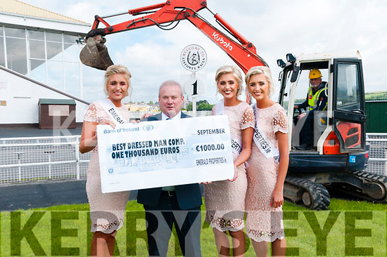 Best Dressed Man: The Crimmins triplet sisters Allison, Nicola & Laura pictured with Pat Harnett of Emerald Properties and Joe Dunne on the digger.