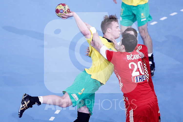 Croatia's Damir Bicanic (r) and Australia's Tommy Fletcher during 23rd Men's Handball World Championship preliminary round match.January 12 ,2013. (ALTERPHOTOS/Acero)