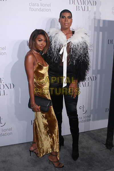 NEW YORK, NY - SEPTEMBER 14: Elisa Johnson and Earvin Johnson, Jr. at  Rihanna's 3rd Annual Diamond Ball at Cipriani Wall Street on September 14, 2017 in New York City. <br /> CAP/MPI99<br /> &copy;MPI99/Capital Pictures