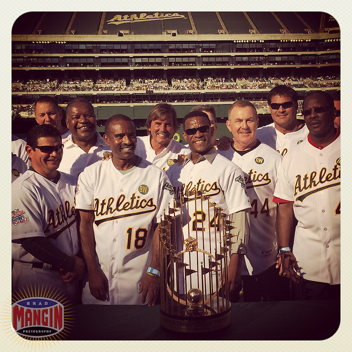 OAKLAND, CA - JULY 19: Instagram of the 1989 World Series team around the trophy as the Oakland Athletics celebrate the 25 year reunion of their 1989 World Series championship team at O.co Coliseum on July 19, 2014 in Oakland, California. Photo by Brad Mangin