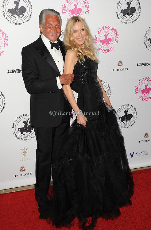 George Hamilton and Alana Stewart arriving at The 2016 Carousel Of Hope Ball held at the Beverly Hilton Hotel Beverly Hills California October 8, 2016.