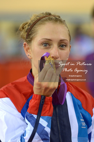 Laura Trott (GBR, Great Britain) kisses her gold medal. Track Cycling - PHOTO: Mandatory by-line: Garry Bowden/SIP/Pinnacle - Photo Agency UK Tel: +44(0)1363 881025 - Mobile:0797 1270 681 - VAT Reg No: 768 6958 48 - 07/08/2012 - 2012 Olympics -Velodrome, Olympic Park, London, England..