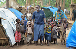 Josephine Murigi, a sister of Our Lady of the Missions and a member of Solidarity with South Sudan, walks with children in a camp for more than 5,000 displaced people in Riimenze, in South Sudan's Gbudwe State, what was formerly Western Equatoria. Families here were displaced at the beginning of 2017 as fighting between government soldiers and rebels escalated.<br /> <br /> Murigi, originally from Kenya, also provides pastoral accompaniment in the Riimenze parish, which has been overwhelmed with the displaced families. <br /> <br /> Solidarity with South Sudan is an international network of Catholic groups that provides training in South Sudan to teachers and health workers, as well as offering pastoral accompaniment to the people of the world's newest nation. Solidarity and Caritas Austria have both supported efforts by the diocese to ensure that the displaced families here have food, shelter and water.