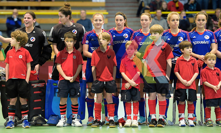GER - Luebeck, Germany, February 06: During the 1. Bundesliga Damen indoor hockey semi final match at the Final 4 between Rot-Weiss Koeln (white) and Mannheimer HC (blue) on February 6, 2016 at Hansehalle Luebeck in Luebeck, Germany. Final score 1-2 (HT 0-2).  <br /> <br /> Foto &copy; PIX-Sportfotos *** Foto ist honorarpflichtig! *** Auf Anfrage in hoeherer Qualitaet/Aufloesung. Belegexemplar erbeten. Veroeffentlichung ausschliesslich fuer journalistisch-publizistische Zwecke. For editorial use only.