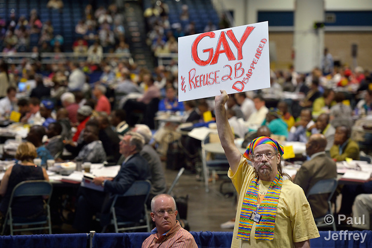One of several demonstrators at the May 1 session of the 2012 United Methodist General Conference in Tampa, Florida, calling on delegates to defeat or remove legislation that discriminates against people based on their sexual orientation.